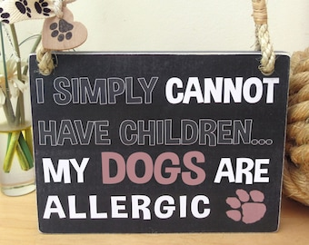 Funny sign for a dog lover - I simply cannot have children...