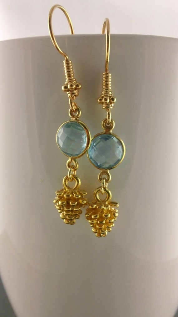 Bezeled sky blue topaz Pine Cone II Faceted Sky Blue Topaz and Pine Cone in vermeiil dangle