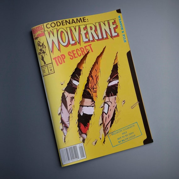 One-of-a-kind comic - Wolverine #50 Comic with acrylic remarque featuring Wolverine peeking through the claw holes.
