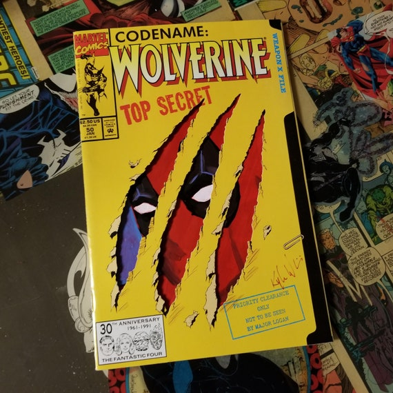 One-of-a-kind comic - Wolverine #50 Comic with acrylic remarque featuring Deadpool peeking through the claw holes.
