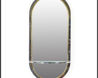 Brass And Chrome oval mirror with a glass shelf
