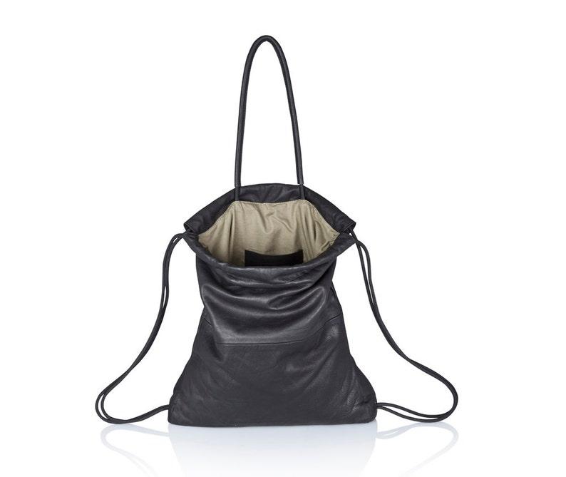 89be6f20fee9a Handbag black leather backpack multi way leather sack bag SALE | Etsy