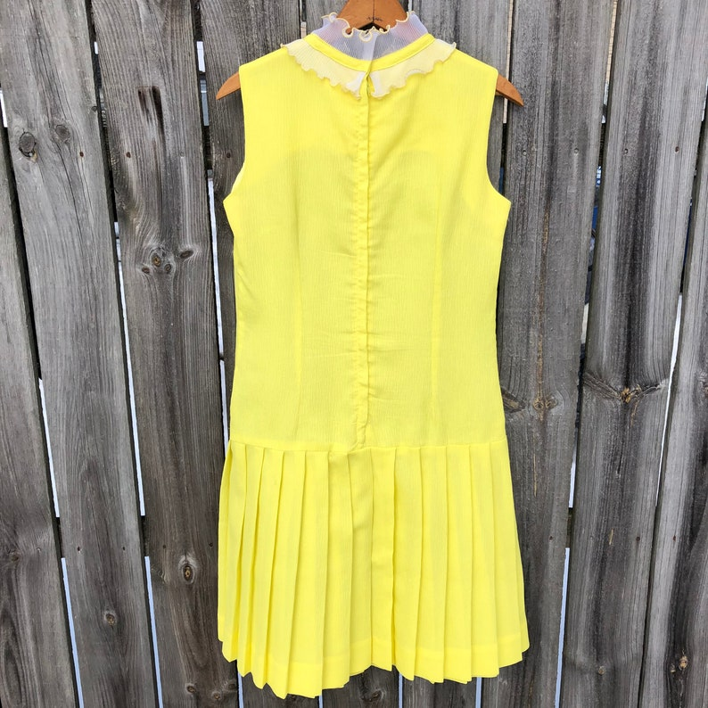 1970s yellow crepe pleated mini dress with ruffle and bow drop waist