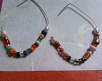 Indian glass bead earrings...No 2 alike. beginning and ending with freshwater pearls.