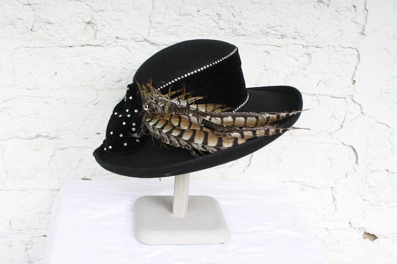 58f74526aee6d 1980s Black Derby Hat   Wide Brim Hat   Vintage Feather Hat