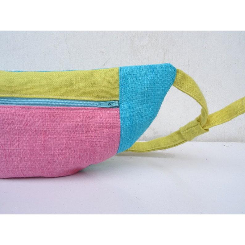 bleu and yellow graphic bumbag Pink