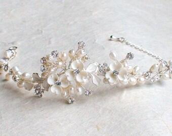 Unique floral style bridal bracelet. Ivory flower pearl bracelet. Bridal accessories. Bracelet. Bridal accessories. Wedding Bracelet.