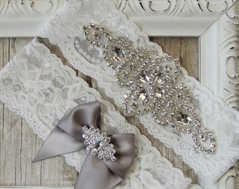 No slip Wedding Garter Set with Rhinestones and satin bow on Comfortable Lace. Bridal Garter Set comes in many colors & can be personalized.