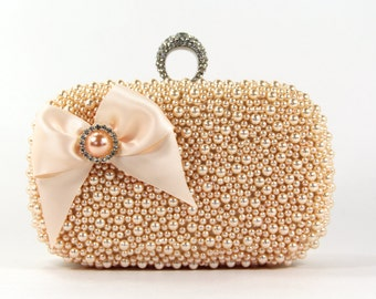Exquisite Peach Pearl Wristlet Clutch Purse adorned with a Lovely Satin Bow & Matching Pearl surrounded by Rhinestones - The Love Story