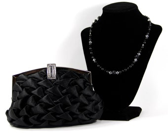 Black vintage inspired satin wristlet clutch purse w/ a Swarovski Crystal & Pearl Handle that can also be worn as a Necklace. The Love Story