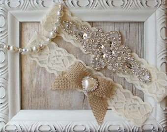 Handmade Rustic Wedding Garter Set made w/ a burlap bow. Customizable, several lace & gemstone colors available. Personalize your set today!