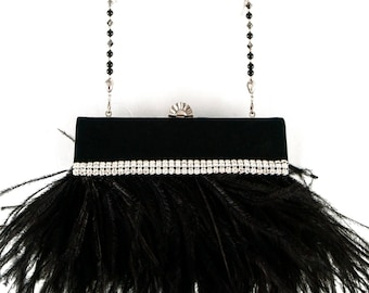Black Satin Clutch with Black Ostrich Feather and a Swarovski & Pave' Crystal Purse Handle/Necklace embellished with Austrian Rhinestones.