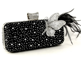 Black satin wristlet clutch purse adorned with a Lovely Crystal Butterfly, Ostrich Feathers, Rhinestones & wispy feathers. The Love Story