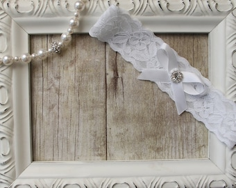 Vintage keepsake lace wedding garter. This garter can be customized as well as personalized. Monogrammed garter, bridal lingerie.