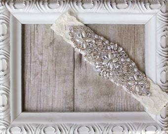 Handmade garter available in several colors of hand dyed stretch lace. Makes a lovely gift and comes beautifully packaged.