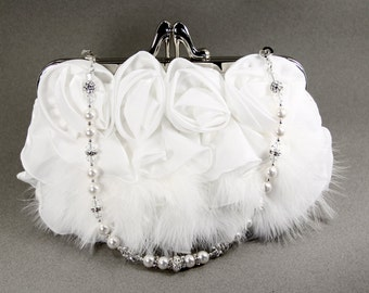 White wristlet clutch purse w/ ethereal Marabou feathers. Handle is made w/ Swarovski Pearls & Crystals and can also be worn as a necklace.