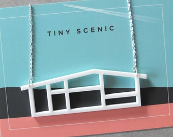 Laser cut house necklace by Tiny Scenic