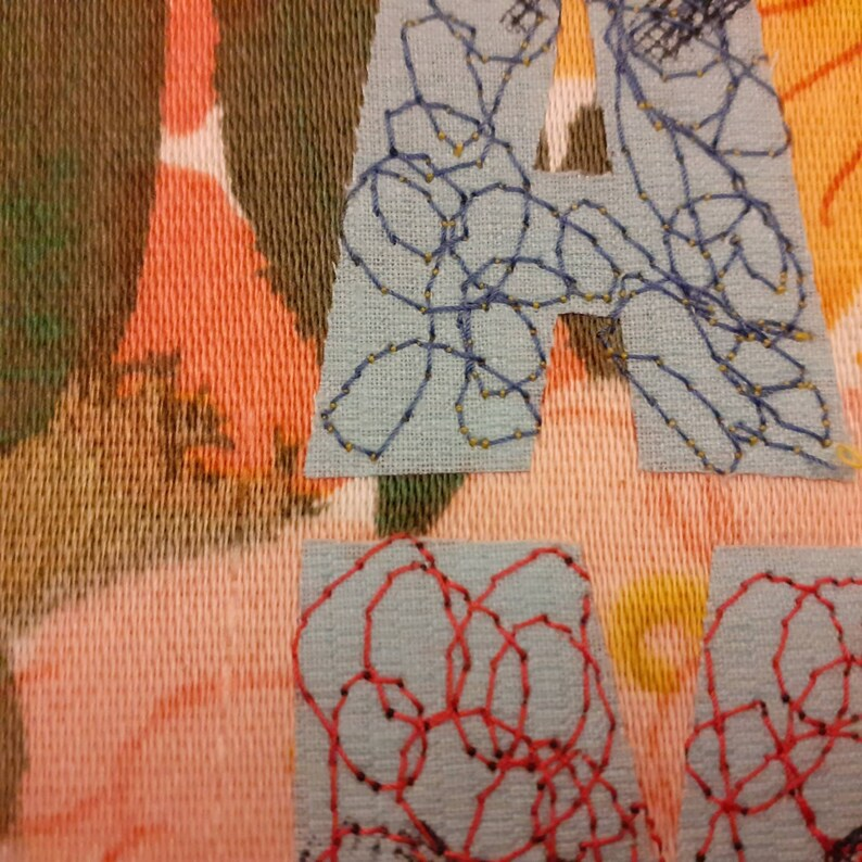 Applique embroidery textile art ready to frame. What about me