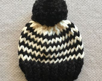 Black and white striped chunky knit baby hat with pom