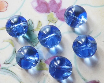Glass buttons, a set of 6, vintage.  Clear blue glass, 1/2 ball shaped, 2 hole sew-thru's. very pretty.  c1930's to 50's.