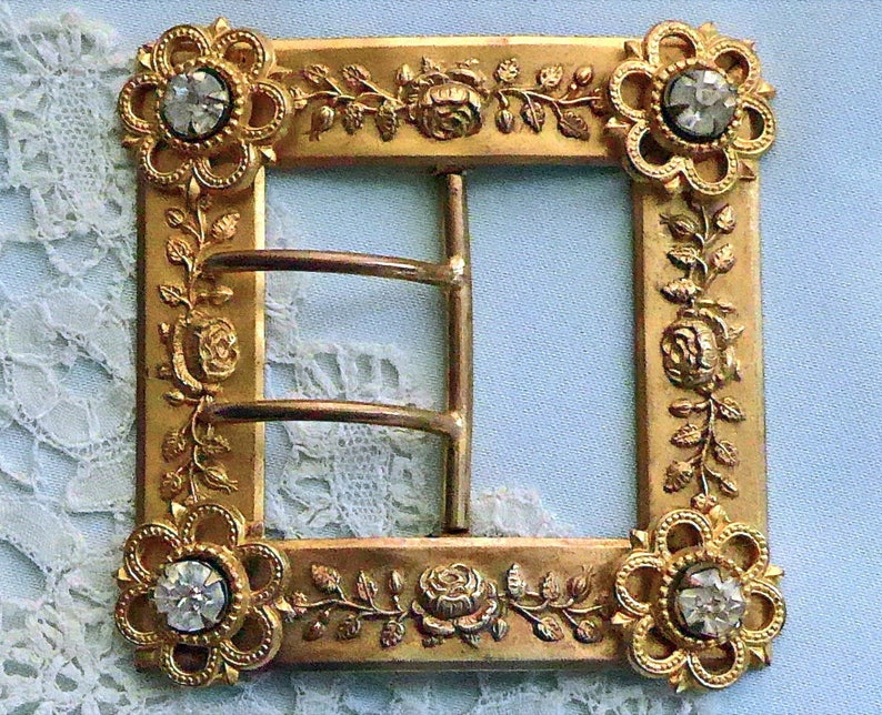 antique Buckle c1900. with floral claw set diamante escutcheon corners Square pressed metal a design of roses 2 prong chape lovely