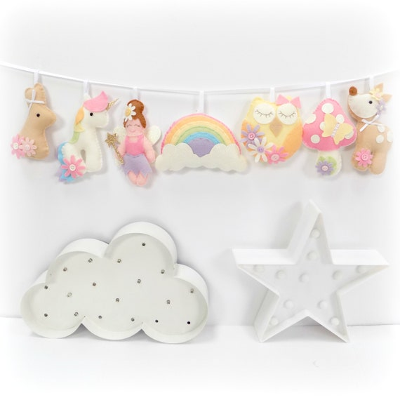 Felt garland craft kit including a fairy, unicorn, bunny, rainbow, owl, toadstool and deer