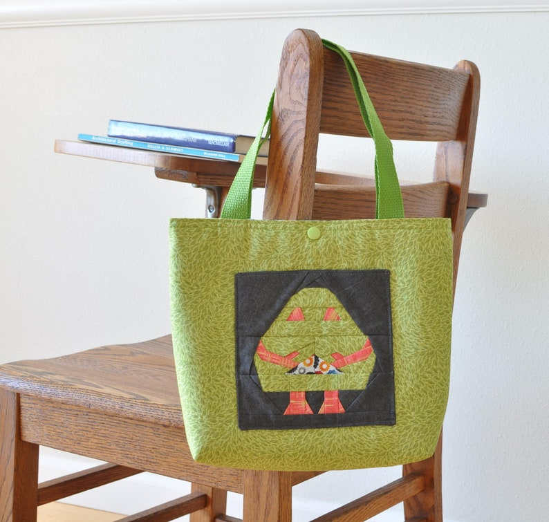 book bag small robot tote bag with Wellington front pocket and snap closure school tote
