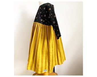 Dress made with Japanese double gauze in mustard stripe and star print cotton in black and gold 3-4 years
