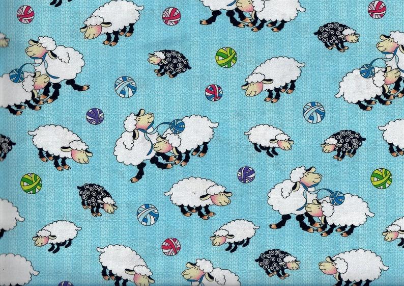 Knit Chicks fabric  sheep balls of yarn  blue black white  image 0