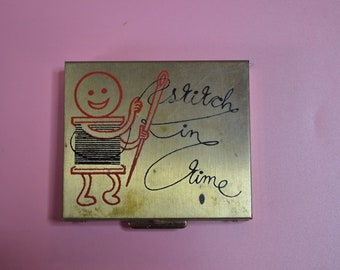 """Little Metal Sewing Kit that says """"Stitch in Time"""""""