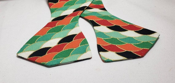 Green, Black, Orange, White and Red Scallop Vibrant Print with Metallic Gold Accent Bow Tie or Face Mask.