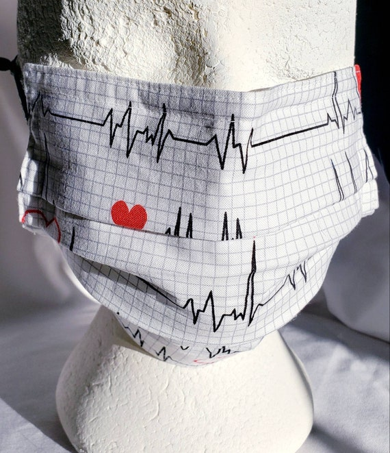 Nurse Heart EKG Face Mask with plastic nose guard, polyester ear hoops, 100% cotton fabric, 7 or 8 inch finish.