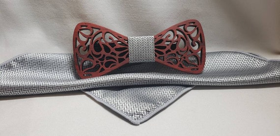 Sculptured Wooden Bow Tie with coordinating knot and pocket square. 5 different color varieties.