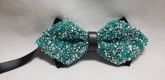 Crystal Rhinestone Bowtie, Satin backing with leather knot. Adjustable up to 19 inches with metal bow tie slides. Assorted colors