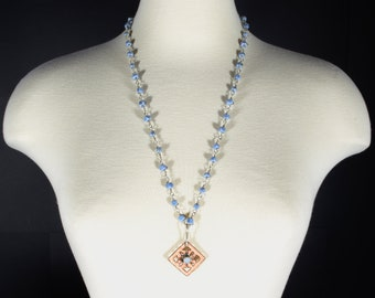 Ellensburg Blue Necklace featuring lampwork glass beads, sterling silver, pierced enamelled copper. Ships free within the USA