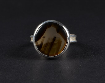 Black Skin Agate Silver Ring: Hand Cut Black Skin Agate set in a Hand formed Sterling Silver by Goodwin and Maxwell. Ships Free in USA.