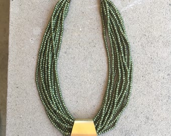 Multistrand Metallic Olive Green Seed Bead Necklace with Large  Chunky Antique Brass Triangle Pendant Caps and Beads