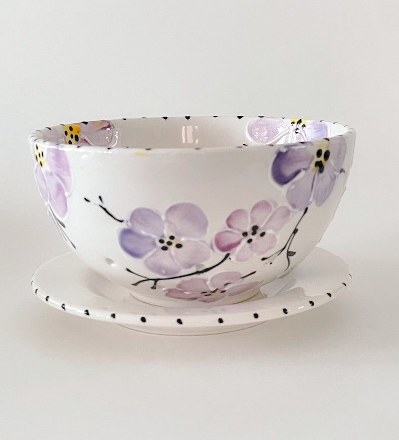 Ceramic berry bowl painted with purple cherry blossoms. This image 0