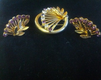 Lovely demi parure with brooch and earrings, gold tone with deep purple rhinestones, signed Coro