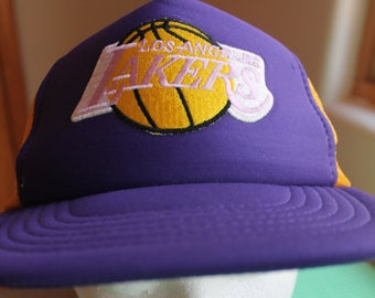 1cb05a73898 70 s LA Lakers Basketball Licensed NBA One Size Trucker Snap Back Hat