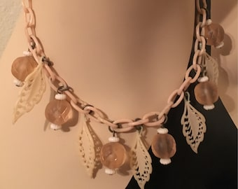 1930s pale pink celluloid chain necklace with glass charms, acorn and leaves
