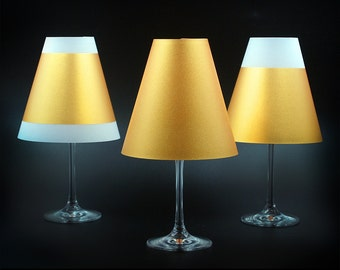 Poetry Light · 3 Golden lampshades for wine glasses with tea light · Made of transparent paper to put together