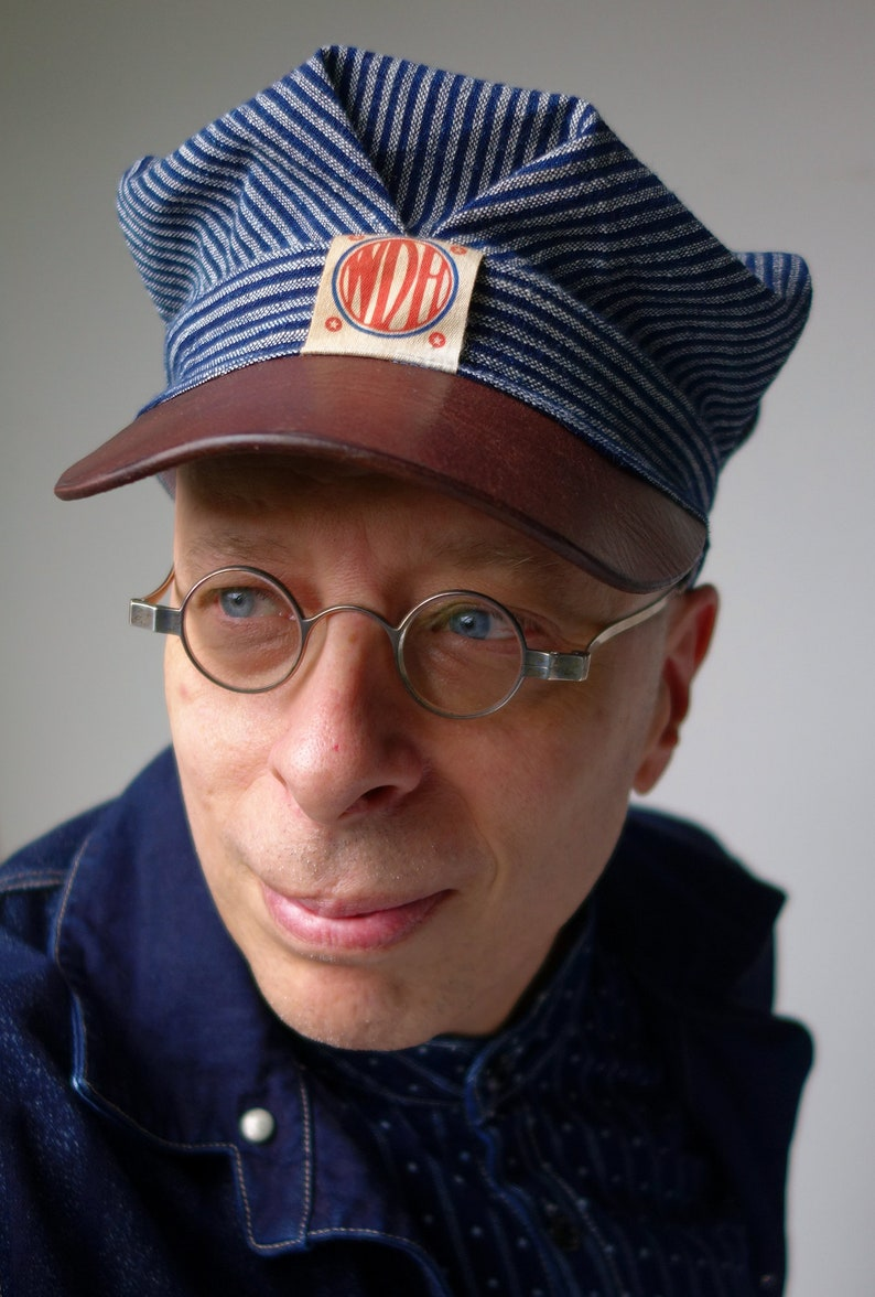Men's Vintage Workwear Inspired Clothing The SWITCHMAN 1910s-pattern Train / Engineers Cap in Antique Bulgarian Homespun Indigo Cotton & Horsehide Visor - Made to Order $179.00 AT vintagedancer.com