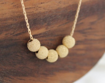 Gold Stardust Necklace • Stardust gold beads on a necklace • Gold jewelry
