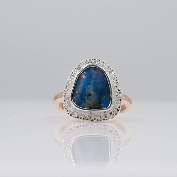 Boulder Opal ring with a Diamond Halo