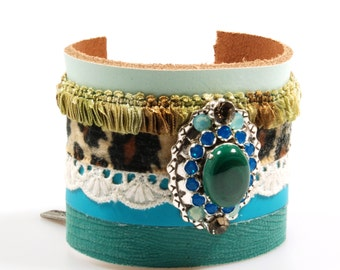 Ultra wide leather cuff in emerald green and turquoise with malachite stone, Swarovski Crystals and with ribbon with leopardprint and lace