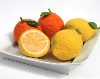 Handcrafted citrus fruits, lemons, oranges as decoration for the apartment