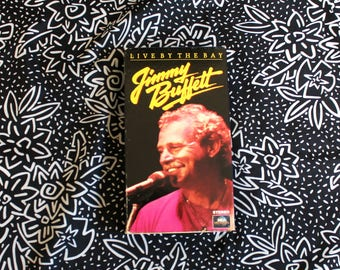 Jimmy Buffett VHS Tape - Live By The Bay Videotape rare VHS Video EP. 1980s Jimmy Buffett Live Concert. Parrot Head Gift