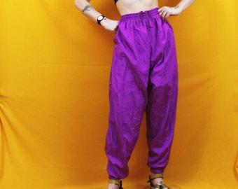 90s Purple Warm Up Jogging Pants. Bright Neon Purple Nylon Work Out Lined Pants. 90s Retro Hip Hop Swishy Pants. Bright 80s Style Warm Ups