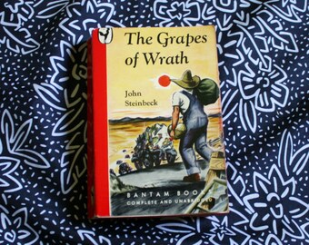 The Grapes Of Wrath By John Steinbeck. 1946 First Edition 6th Printing Bantam Books Edition Paperback Book. Classic Literature Book